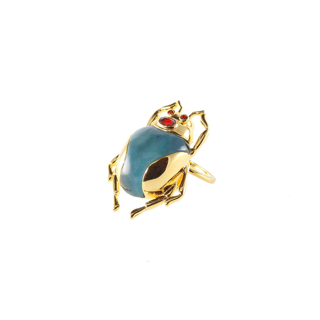 gold plated beetle ring with blue stone and red crystal eye