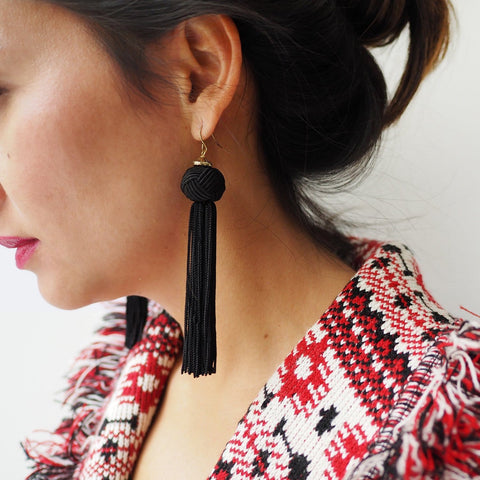 These fun black earrings have a knot which cascades into a long tassel.  Great when you want to add some swing to your outfit.