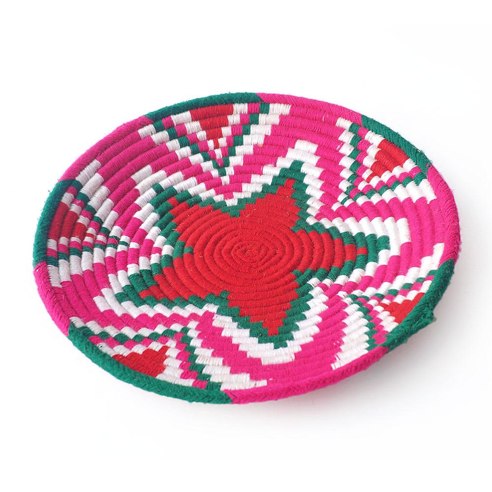 These colourful weaved basket trays are colourfully enhanced with wool thread to give them that incredible pop of colour.  A great decorative item, to put in your foyer to throw your keys in when you get home, or have on a coffee table or bedroom for trinkets.  If you love colour you can't go wrong with one of these.  All one of a kind.