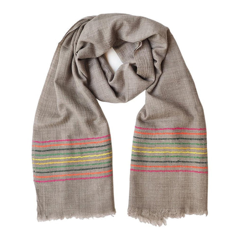 A natural coloured pashmina is given an added touch of colour with some modern stitching.  This scarf comes from the Himalayan region of India.  Made out of the finest Ibex wool, it will keep you warm and add some colour to your dreary winter outfit.