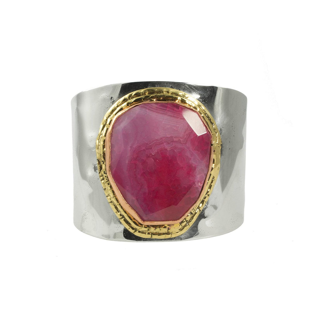 The pink agate adds colour to this classic design. The steel body has a hammered finish which gives this cuff a hewn look.