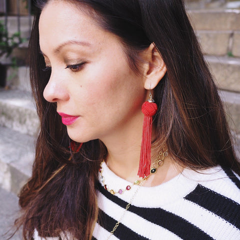 Colourful and fun these red earrings have a Knot which cascades into a long tassel.  Great when you want to add some colour to your outfit.