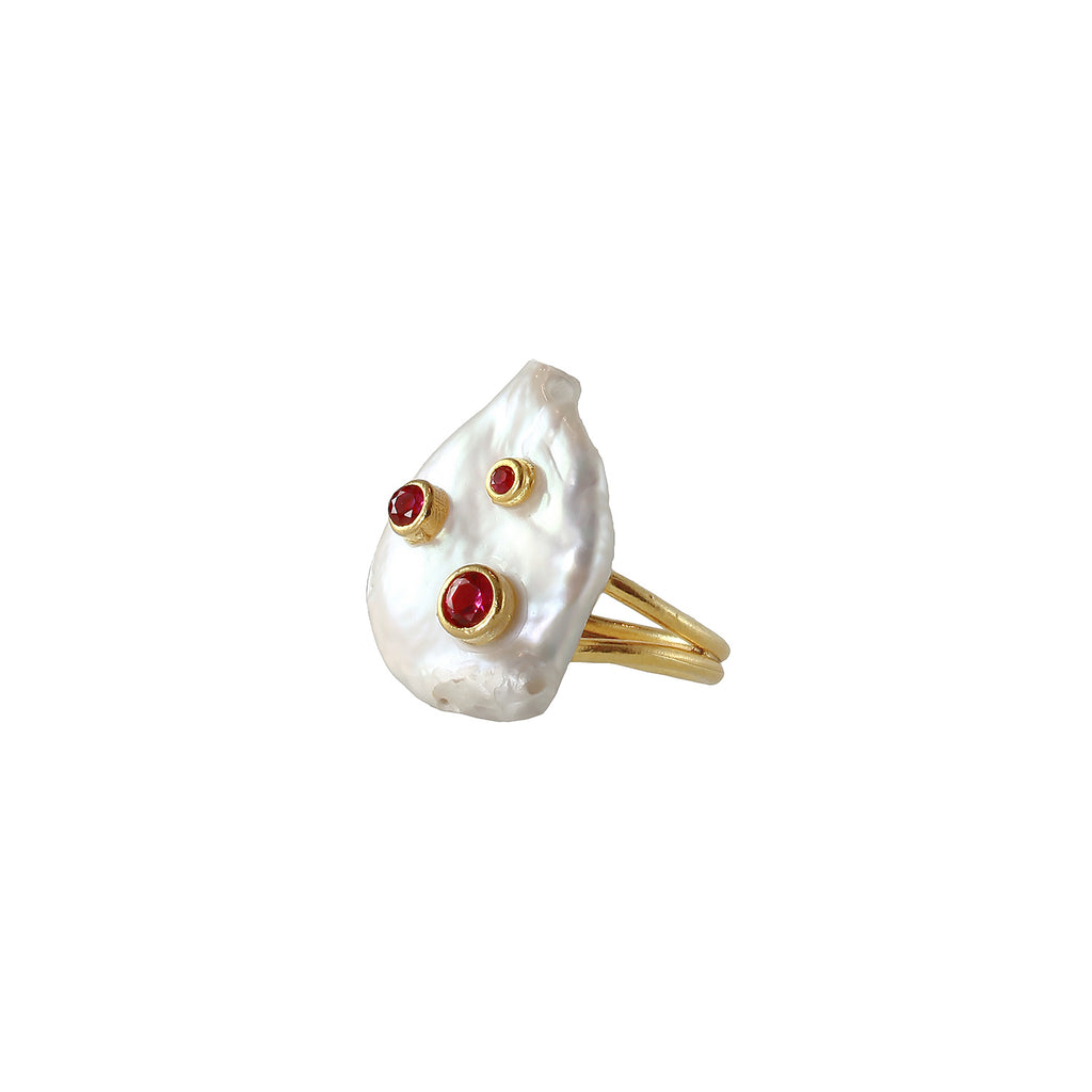 Coin pearl ring with sliver gold plated and red garnet stone set on it