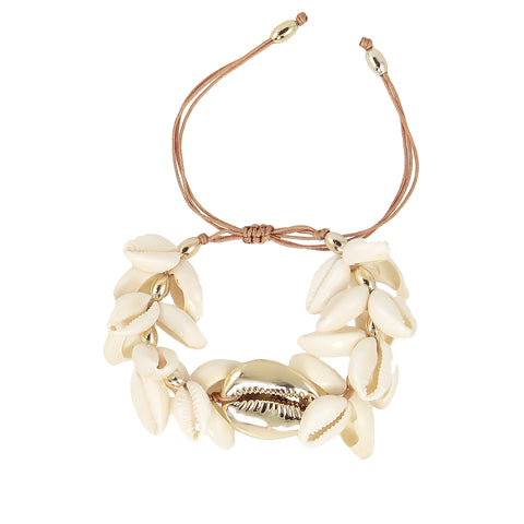 White cowry shells with large gold plated shell bracelet and golden beads