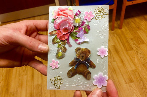 beginner's handmade card using embossing and decoupage during group activities with donated supplies