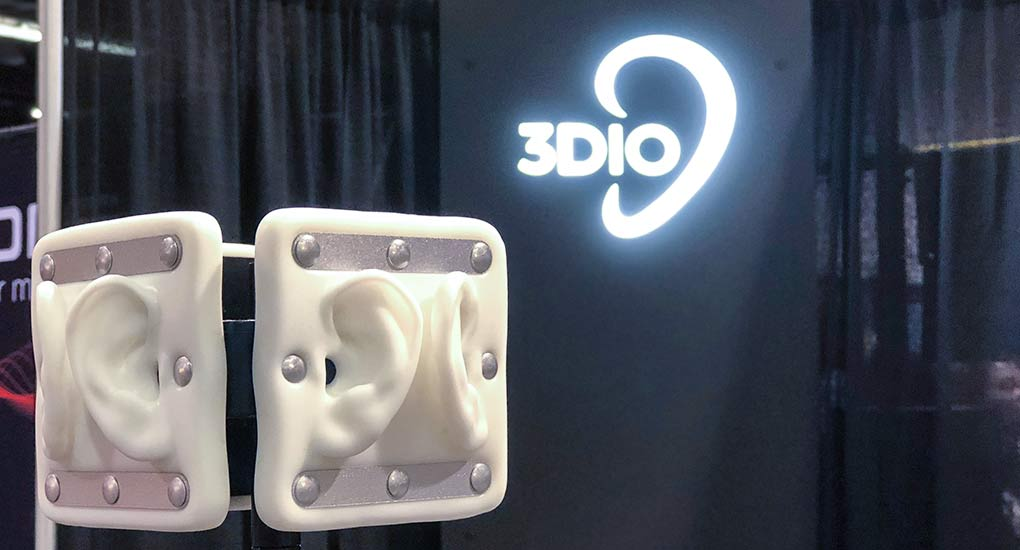 Image of a 3Dio Omni binaural microphone with a glowing 3Dio logo in the background.