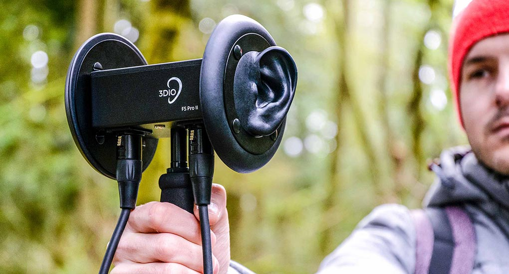 Image of man holding a 3Dio FS Pro II binaural microphone