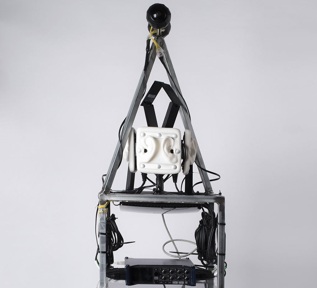 Image of a custom VR backpack featuring 360Fly cameras, a 3Dio Omni binaural microphone and a Zoom F8 digital recorder.