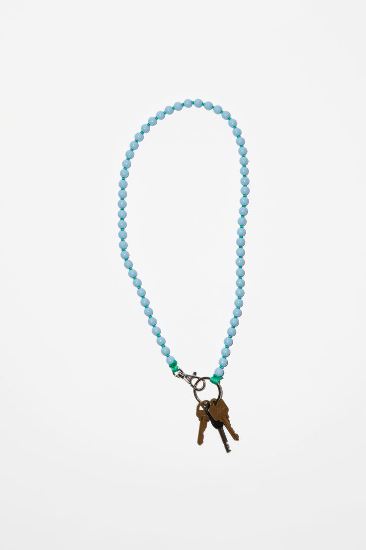 Image of Ina Seifart Perlen Long Keyholder in Pastel Blue with Green Thread