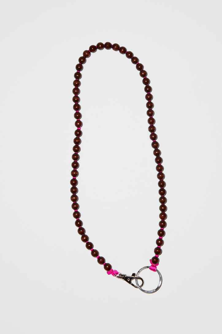 Image of Ina Seifart Perlen Long Keyholder in Brown with Pink Thread