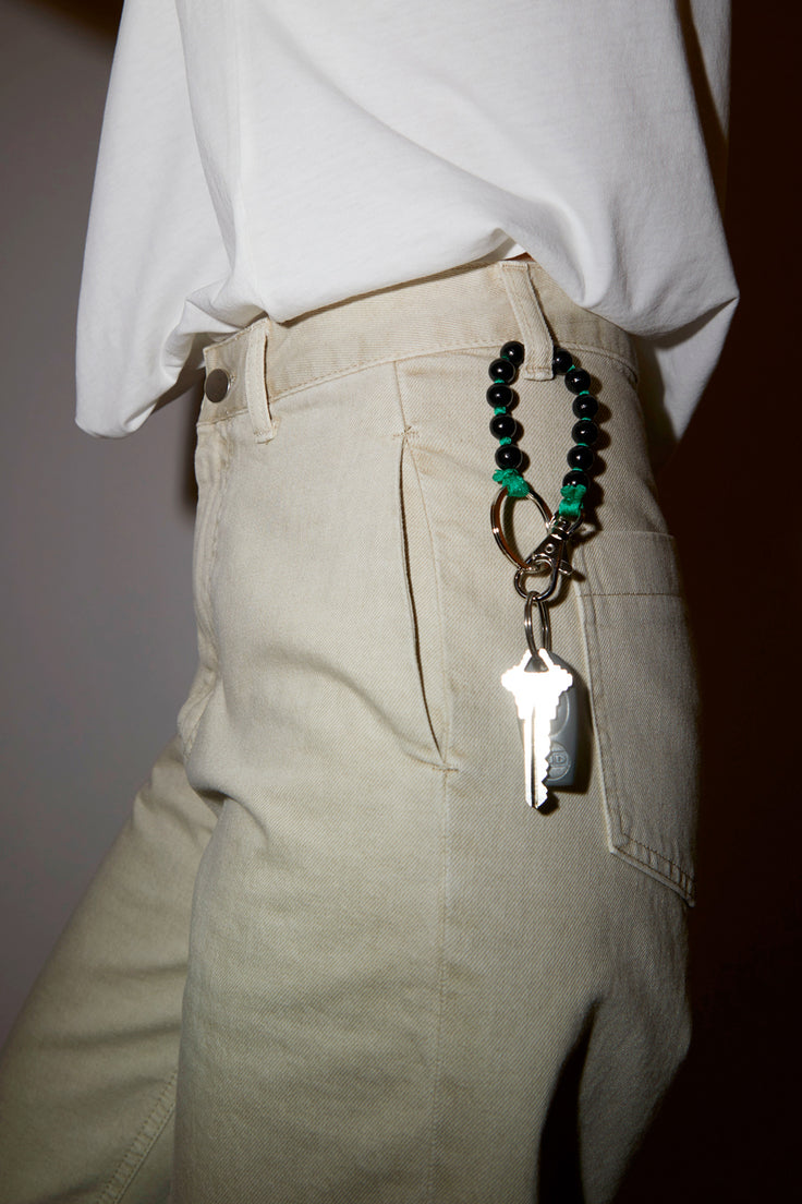 Image of Ina Seifart Perlen Short Keyholder in Black with Green Thread