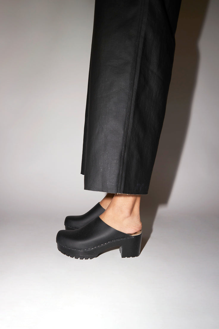 Image of No.6 Liza Clog on Mid Tread in Black with Zebra Shearling on Black Base