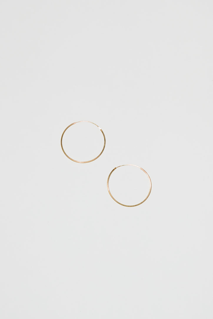 Image of Ninfa Balance Snake Large Hoop Earrings