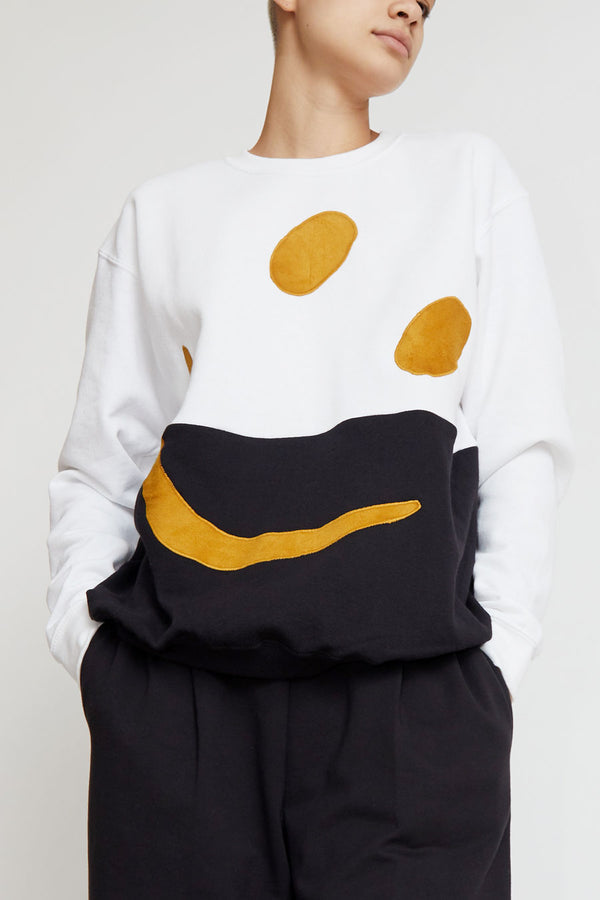 Astrid Deigner Dividend Face Sweater in White, Black, and Gold