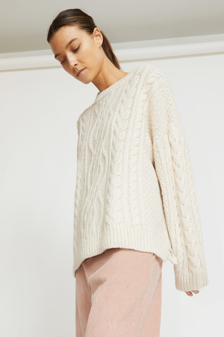 Image of Mijeong Park Oversized Cableknit Sweater in Cream