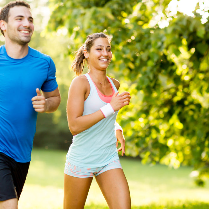 Young Couple, Man & Woman, Running & Exercising together to stay healthy & fit