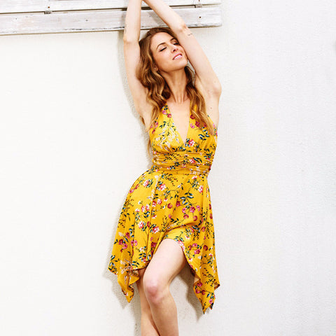 Yellow Floral Backless Romper by Pesci Moda