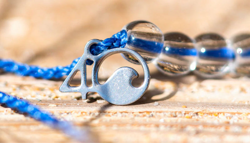 The original 4ocean Clean the Ocean Signature Braided Bracelet - 4O Charm