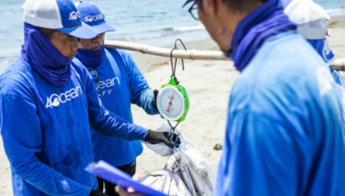 Crew members weighing trash pulled from the ocean.