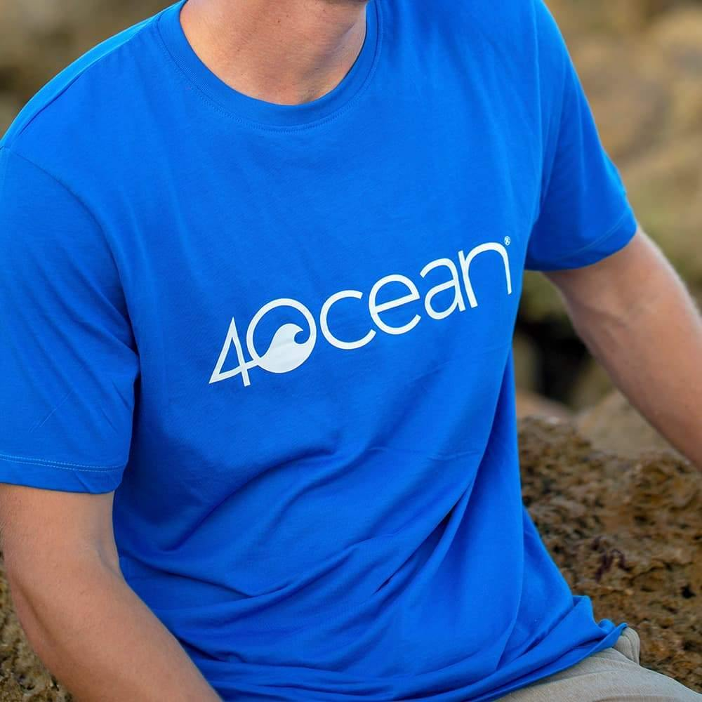 4ocean logo unisex men's and women's t-shirt on a man - blue