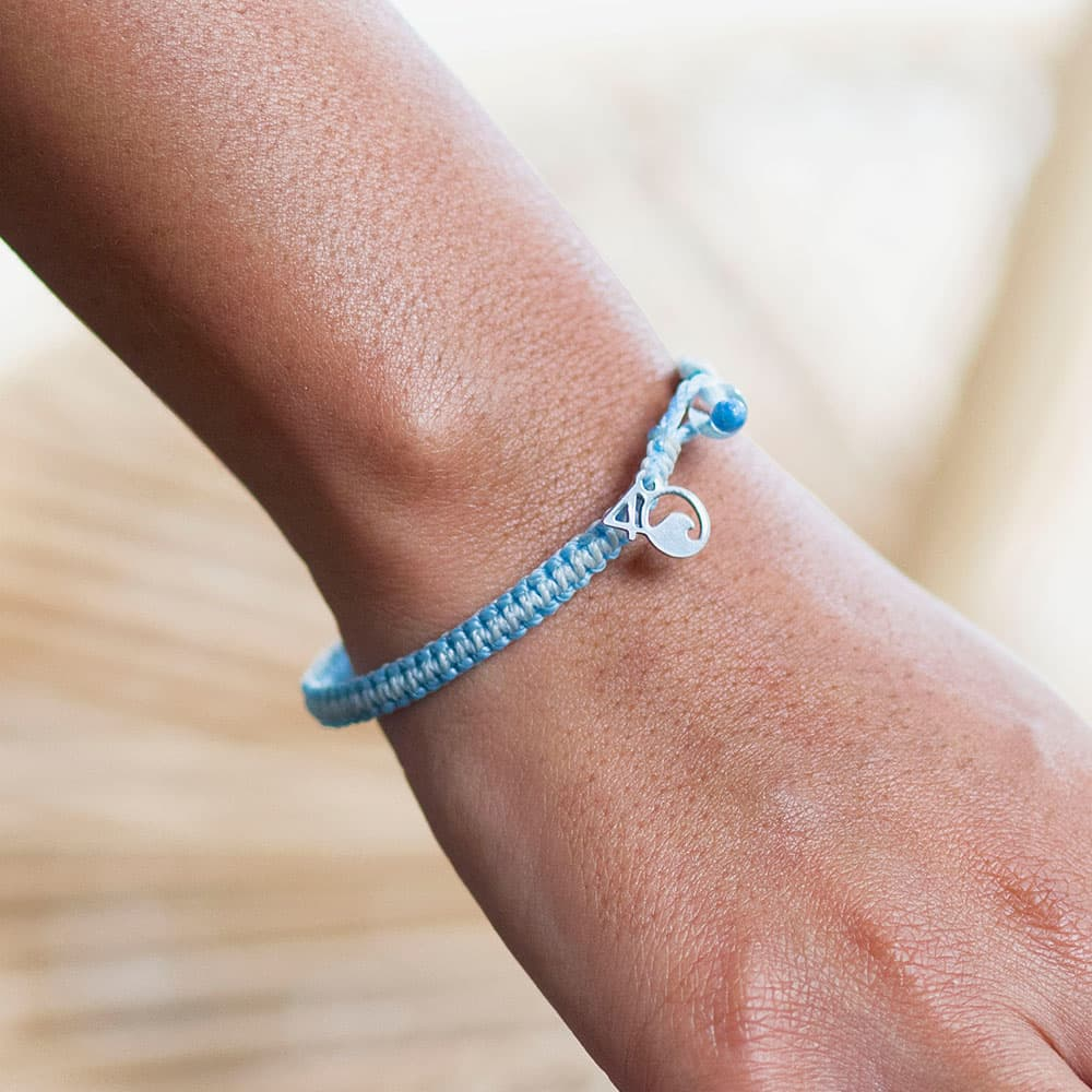 A Person Wearing the 4ocean Beluga Whale Braided Bracelet
