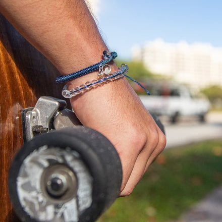 A Person Wearing the 4ocean Bluefin Tuna Beaded and Braided Bracelet 2-Pound Pack
