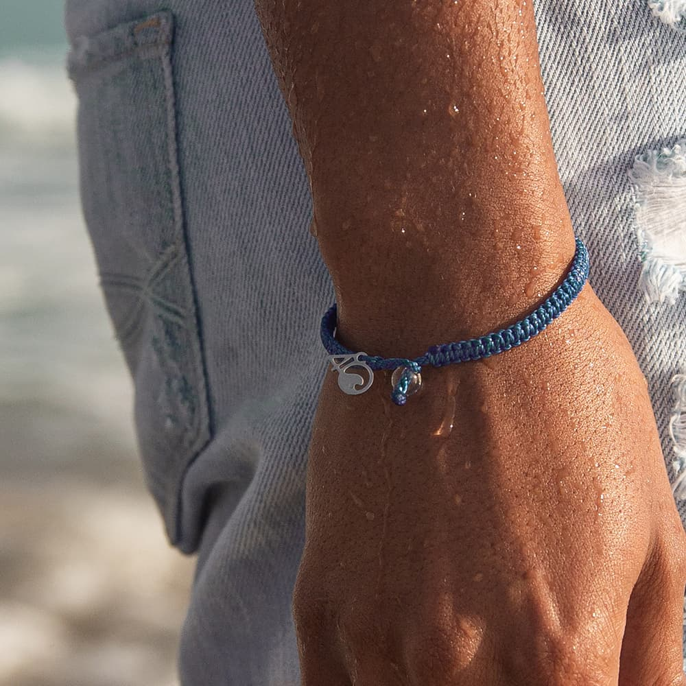 A Person Wearing the 4ocean Bluefin Tuna Braided Bracelet on a Wrist