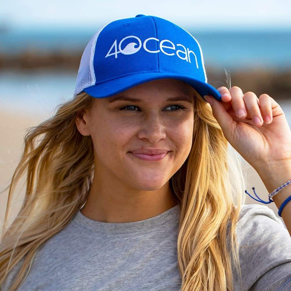 Woman Wearing the 4ocean Logo Classic Trucker Hat