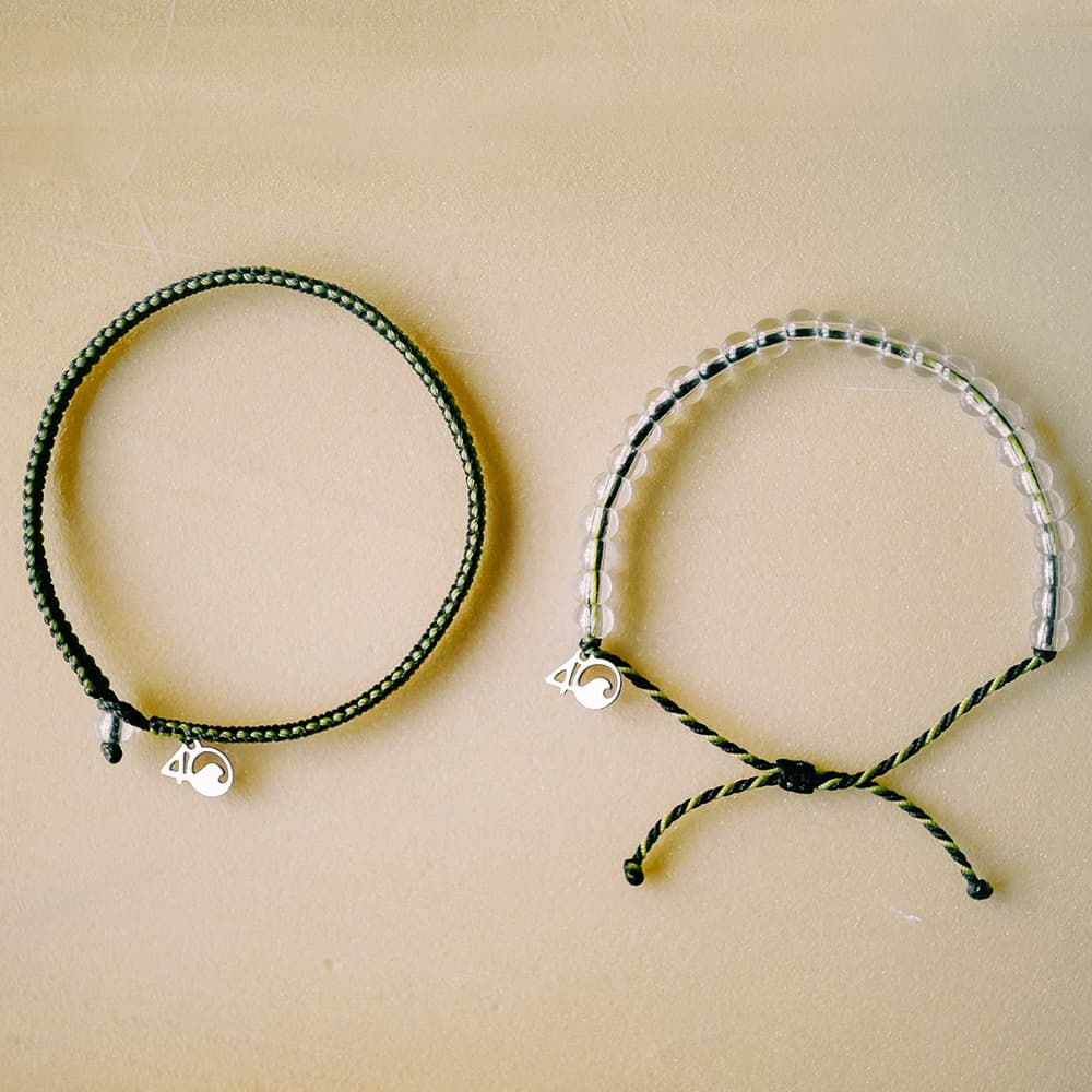 4ocean Penguin Black and Yellow Beaded and Braided Bracelet 2-Pound Pack Laydown