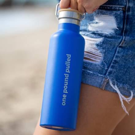 Pull 3 Pounds with the 4ocean On-the-Go Holiday Bundle Featuring the 4ocean Reusable Bottle, Sandwich-Size Stasher Bag and the To-Go Wear Bamboo Utensil Set