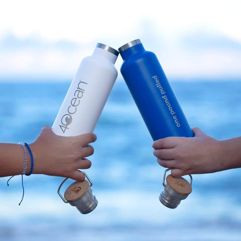 4ocean Reusable Water Bottle Comes in 4ocean Blue or White with 4ocean Logo on the Front and One Pound Pulled on the Back