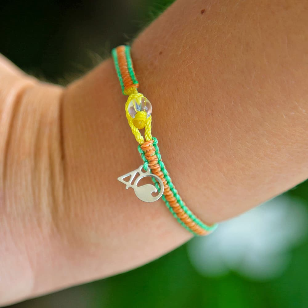 A closeup of the 4ocean Sea Star Starfish Braided Bracelet on a Wrist