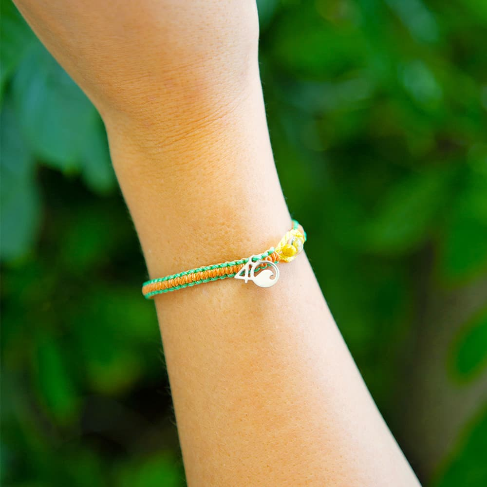 A Woman Wearing the 4ocean Sea Star Starfish Braided Bracelet