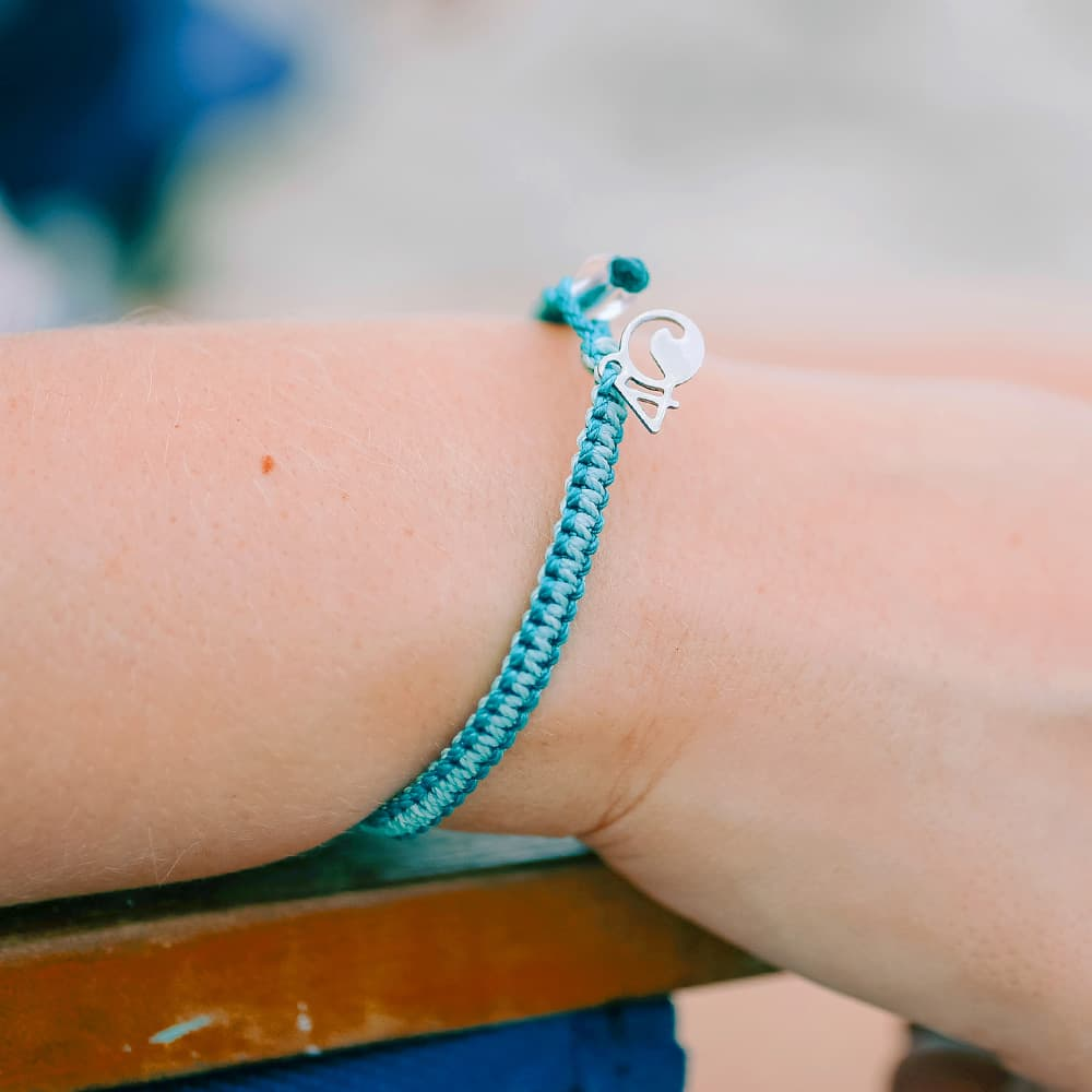 4ocean Manta Ray Braided Bracelet on a Wrist Closeup