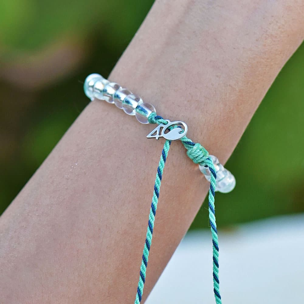 A person wearing the 4ocean Stingray Limited Edition Beaded Bracelet