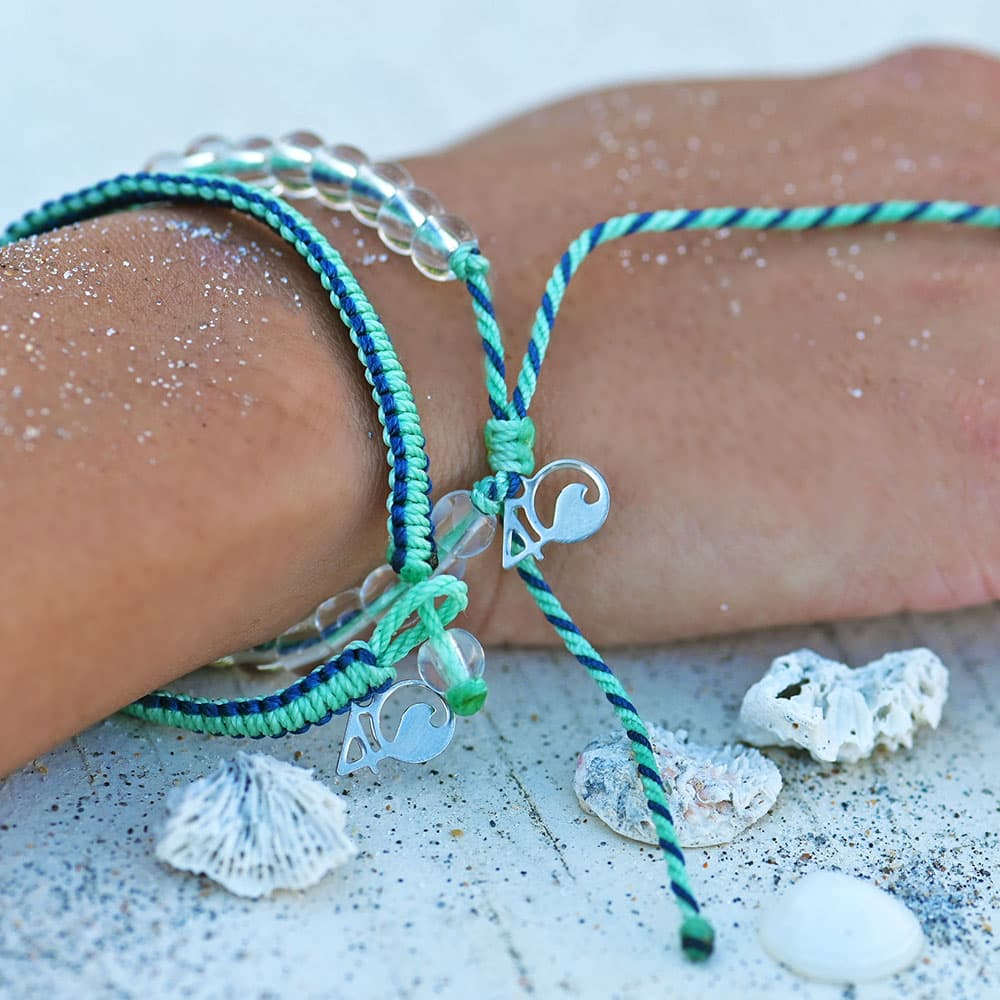 Closeup of the 4ocean Stingray Limited Edition Beaded and Braided Bracelet 2-Pound Pack on a wrist