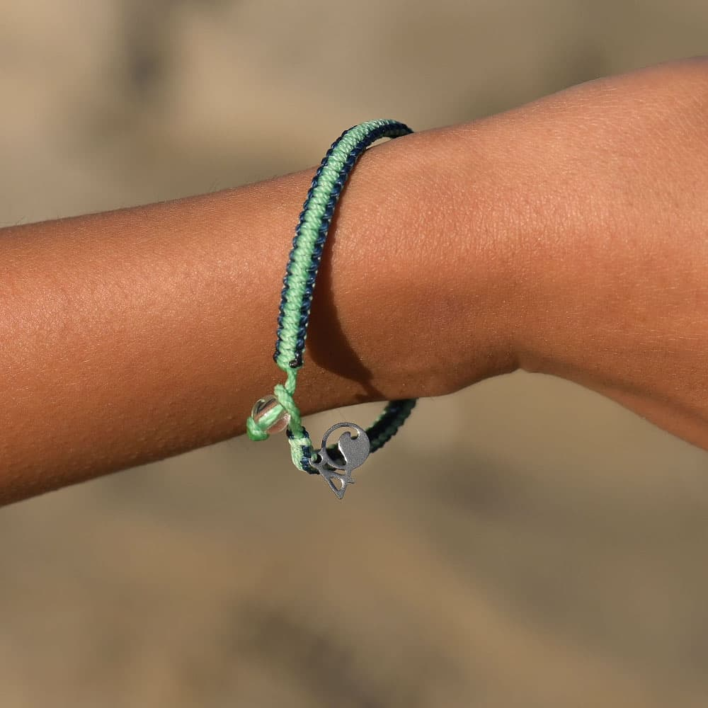A person wearing the 4ocean Stingray Limited Edition Braided Bracelet