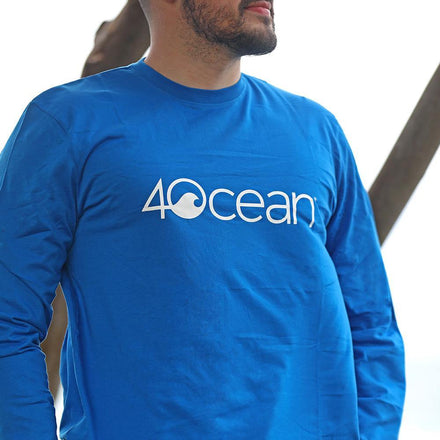 A Man Wearing the 4ocean Unisex Long Sleeve T-Shirt Blue