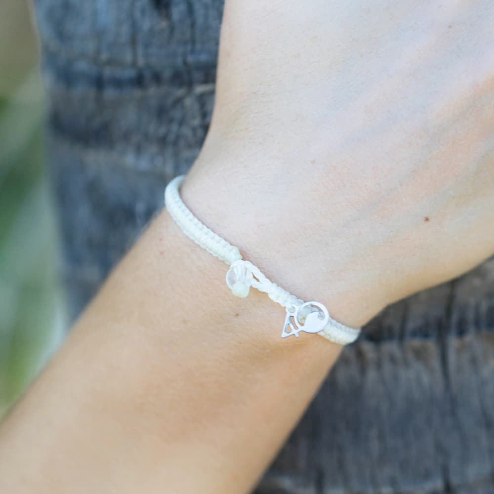4ocean Polar Bear Braided Bracelet on a woman's wrist