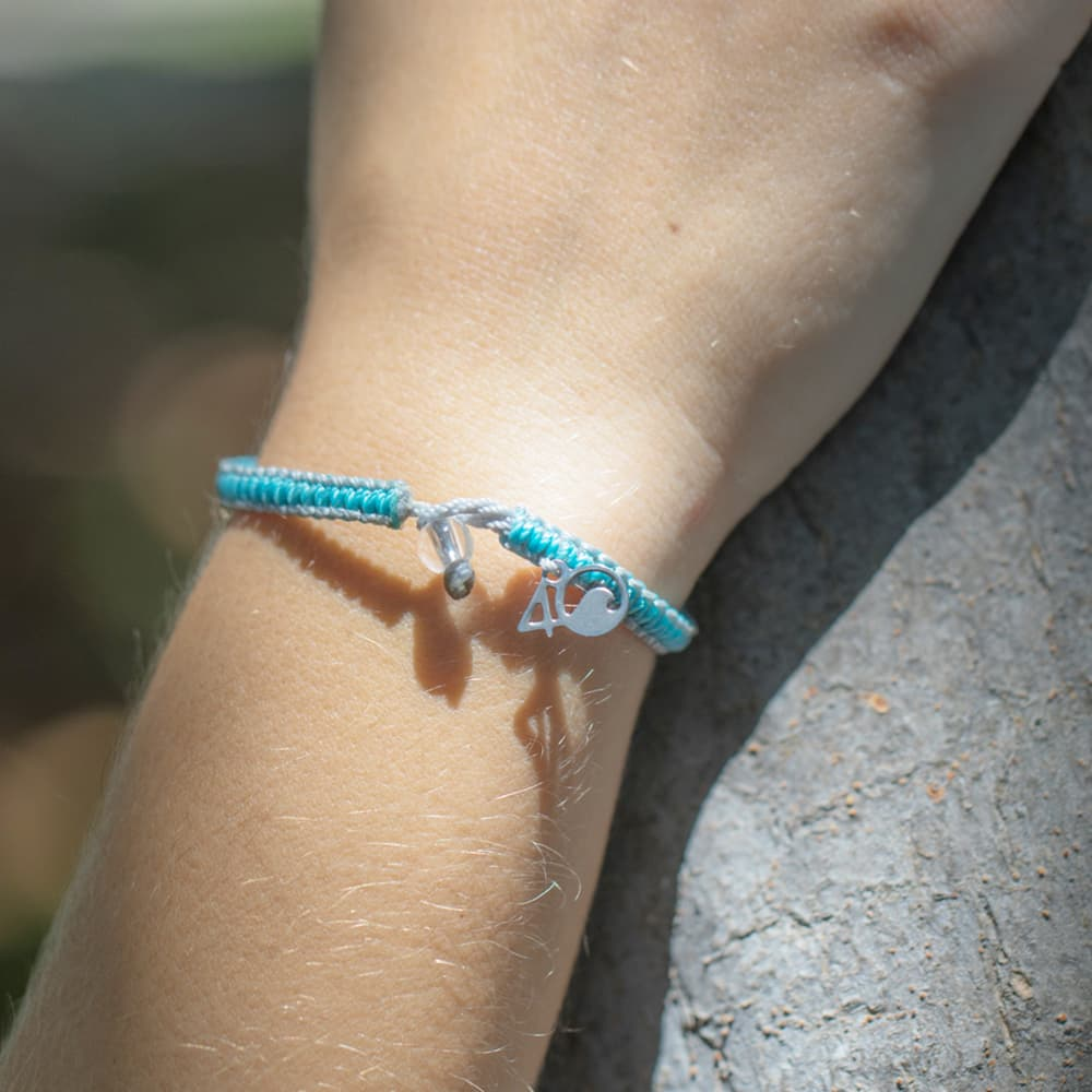 4ocean Dolphin Braided Bracelet On a Wrist