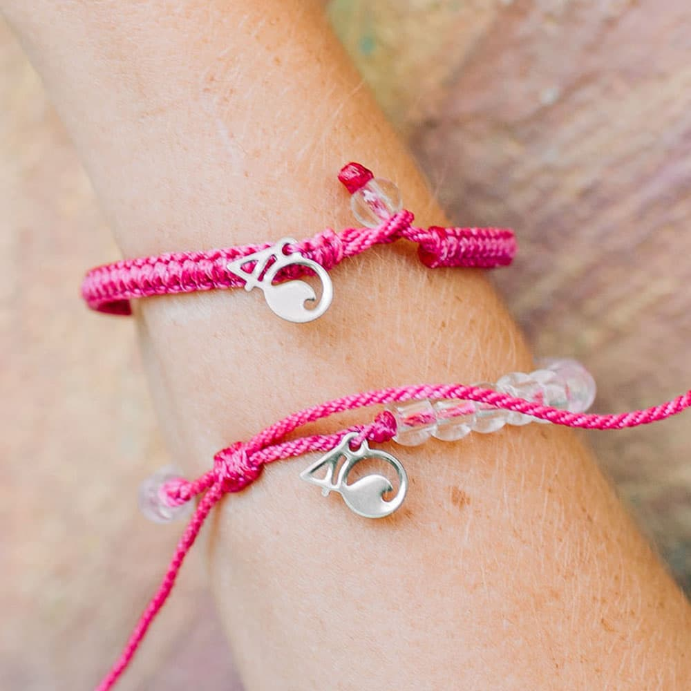 4ocean Pink Flamingo Beaded and Braided Bracelet 2-Pound Pack on a wrist closeup
