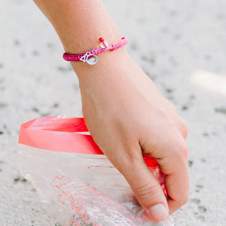 4ocean Pink Flamingo Braided Bracelet on a Wrist