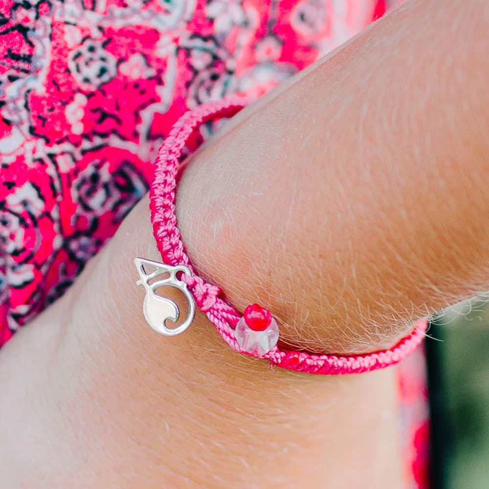 4ocean Pink Flamingo Braided Bracelet Closeup on a Wrist