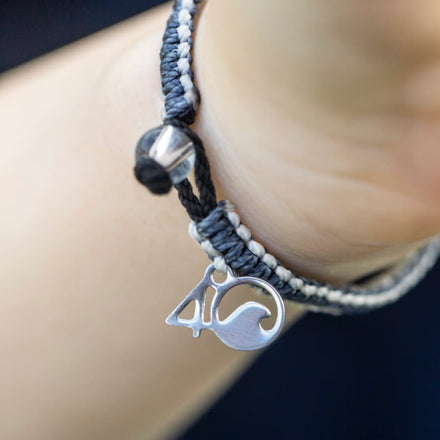 4ocean Great White Shark Braided Bracelet close-up on a woman's wrist