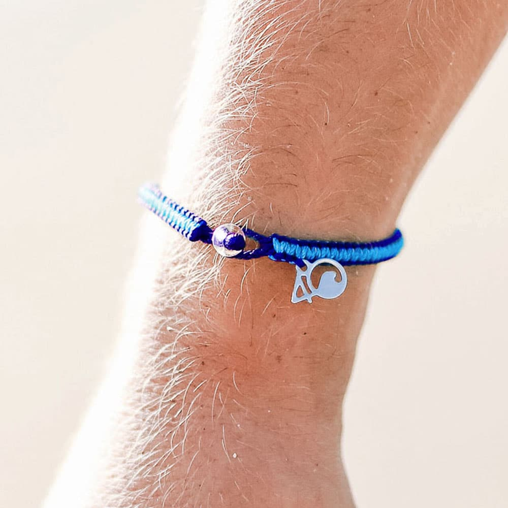 A Person Wearing The 4ocean Harp Seal Braided Bracelet