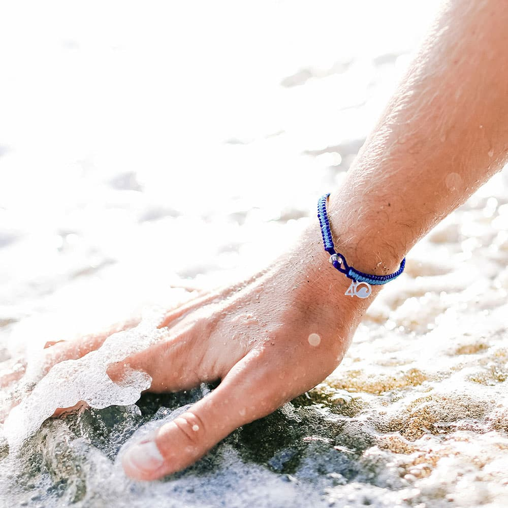 The The 4ocean Harp Seal Braided Bracelet on a Wrist