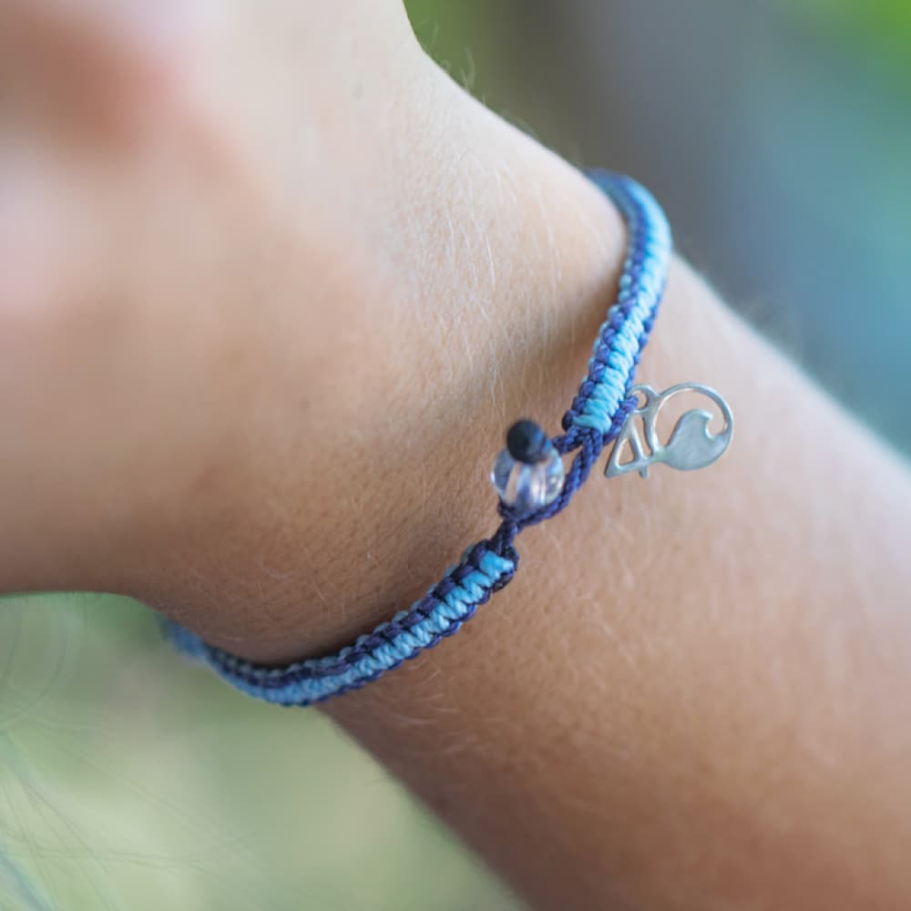 The 4ocean Whale Braded Bracelet On a Wrist