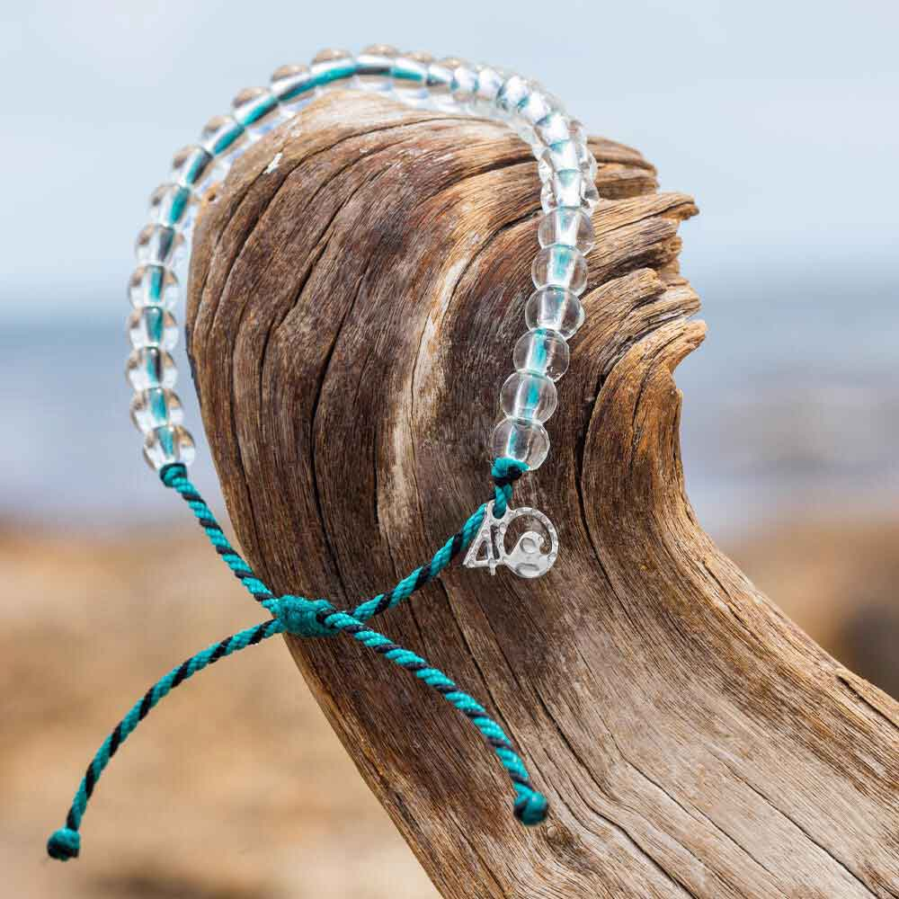 4ocean Sea Otter Beaded Bracelet on a log
