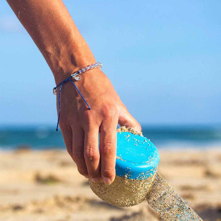 The original 4ocean Clean the Ocean Signature Braided Bracelet pulling plastic from the ocean