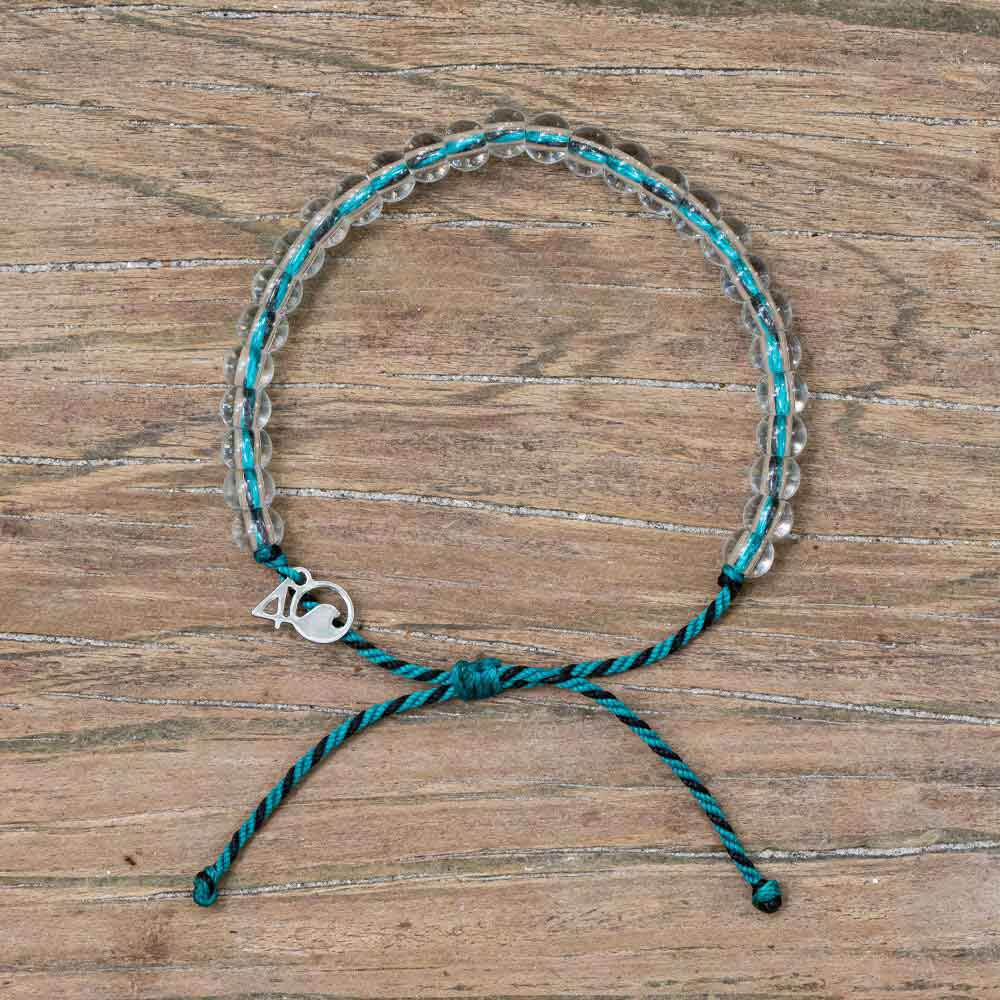 4ocean Sea Otter Beaded Bracelet on a wooden background